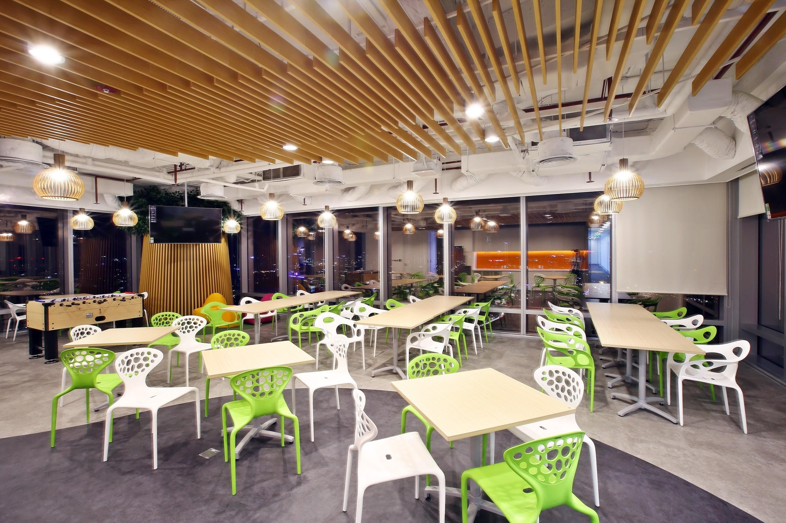 An open dining room in pair with table top football for employees to relax and entertain
