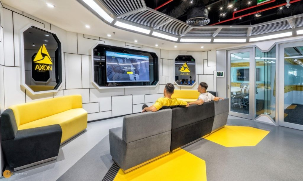 black and yellow colors are used in office design of Axon